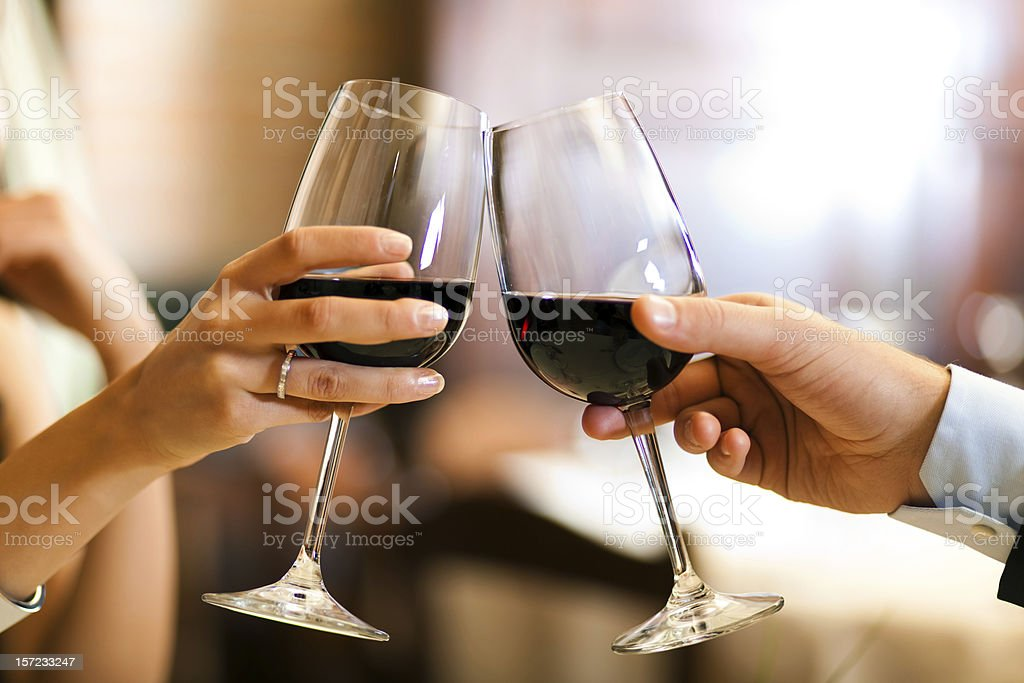 Couple toasting wine glasses stock photo
