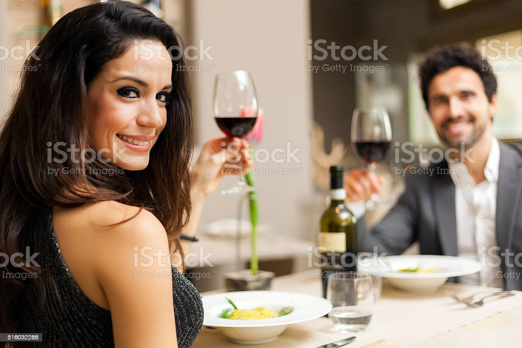 Couple toasting wineglasses in a luxury restaurant stock photo
