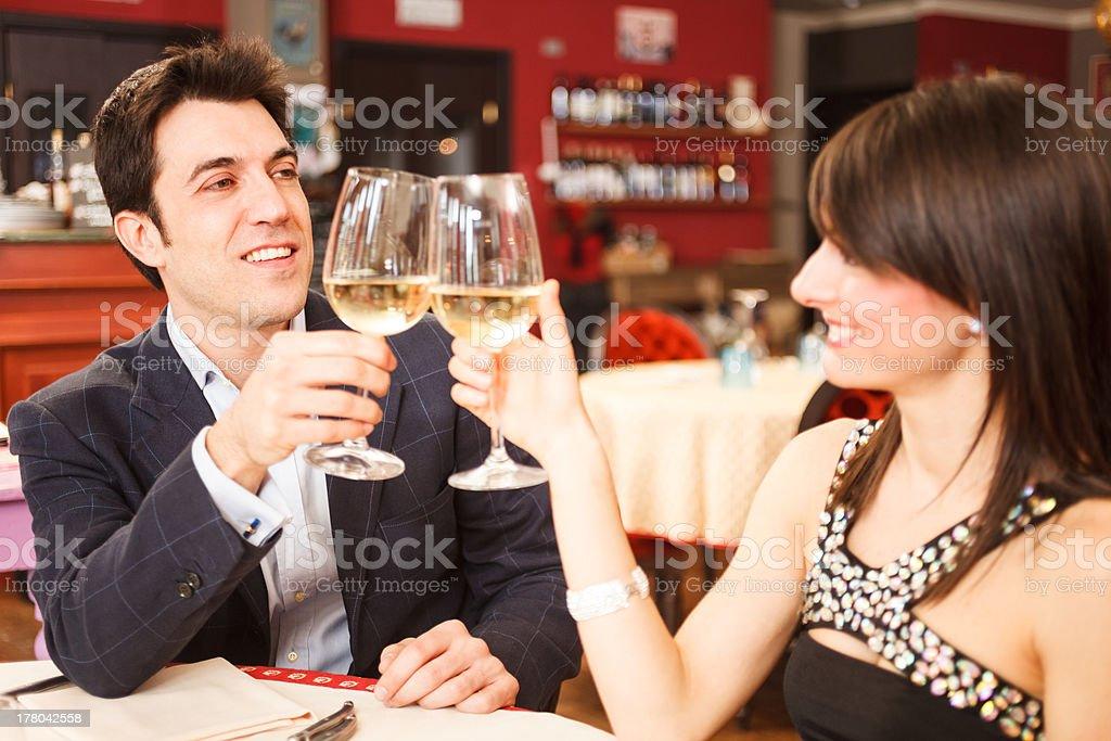 Couple toasting wineglasses royalty-free stock photo