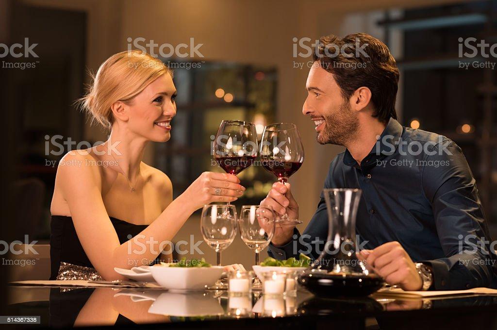 Couple toasting wineglasses stock photo