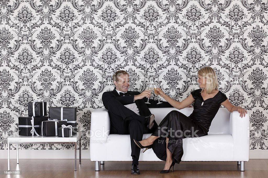 Couple toasting with champagne royalty-free stock photo