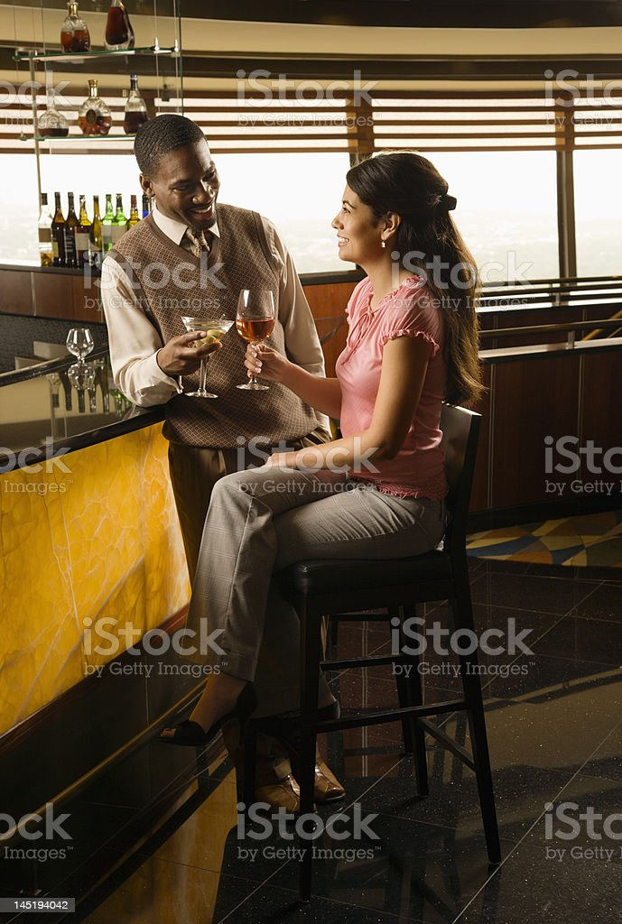 Couple toasting with drinks. royalty-free stock photo