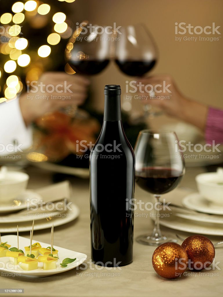 Couple toasting with red wine at dinner table royalty-free stock photo