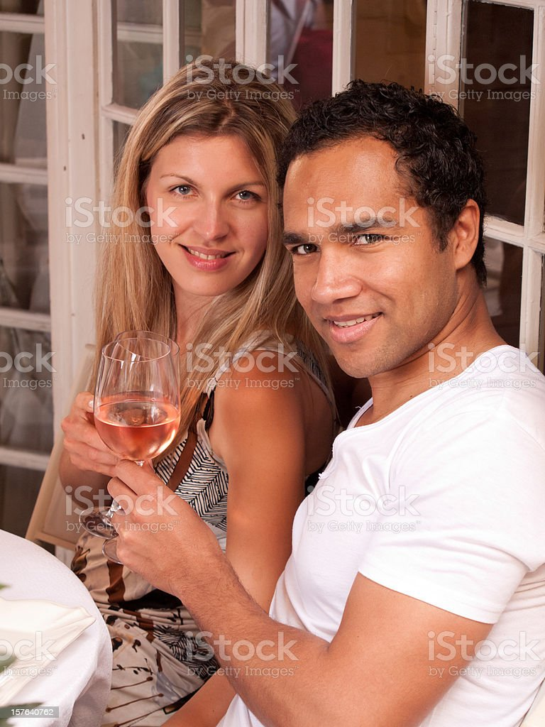 Couple toasting with white wine, Cannes, France royalty-free stock photo