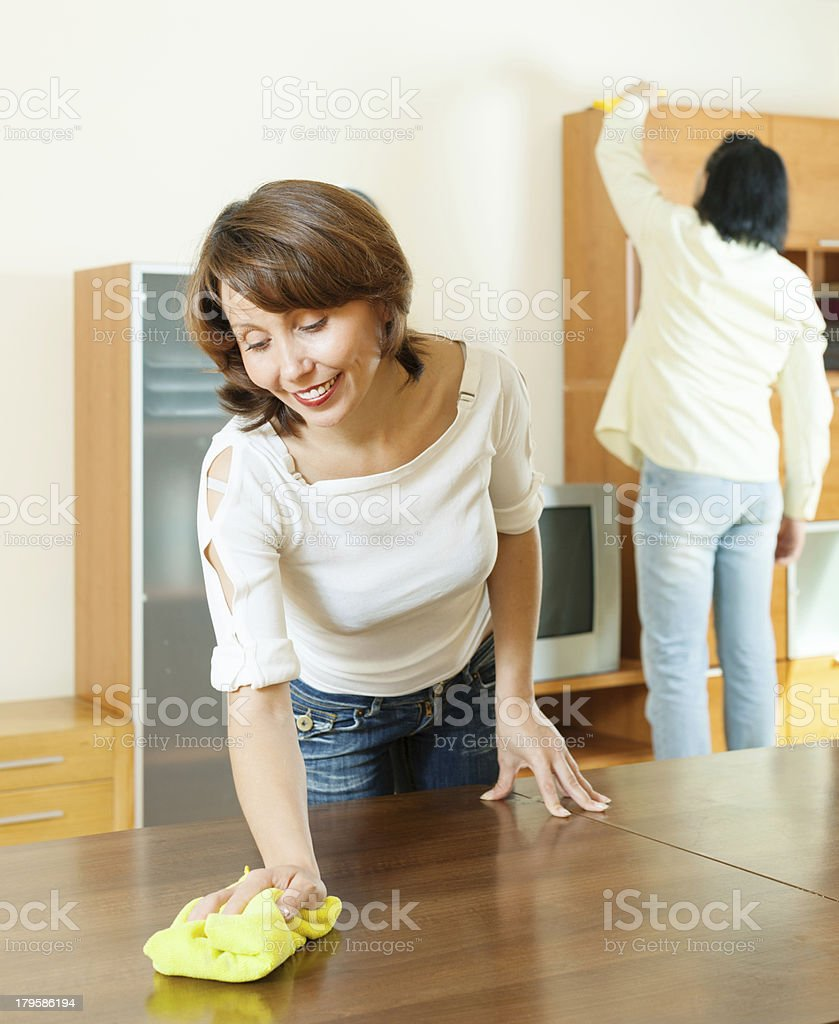 couple together doing chores at home royalty-free stock photo