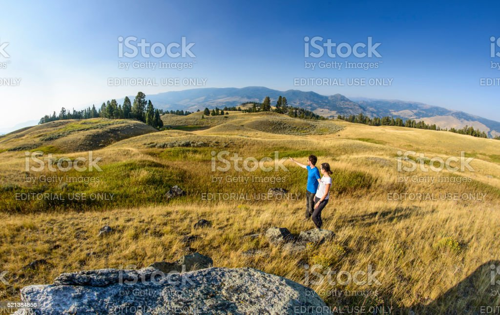 Couple together looking and pointing at Blacktail Plateau royalty-free stock photo