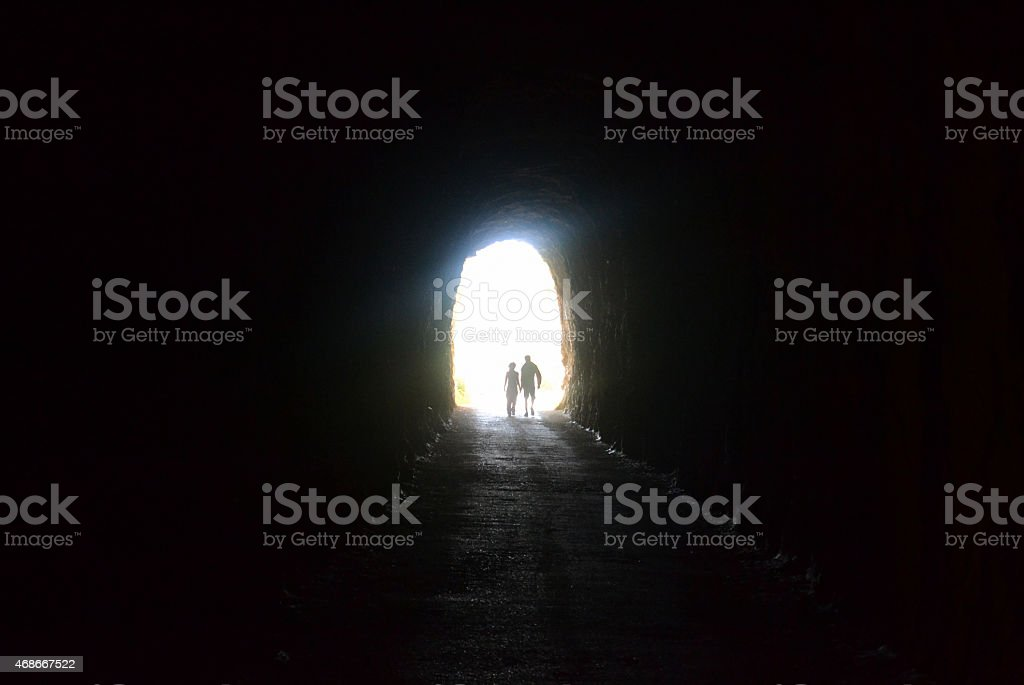 Couple together out of a cave stock photo