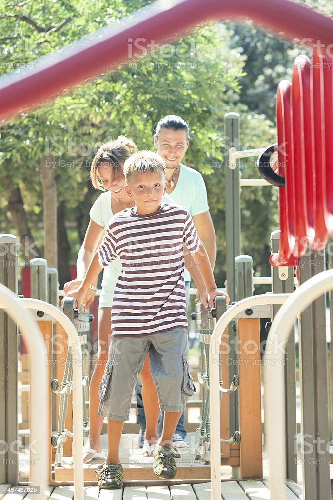 couple together with teenager overcoming the obstacle course stock photo