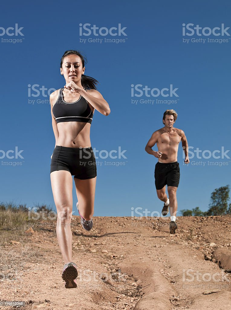 Couple Trail Running royalty-free stock photo