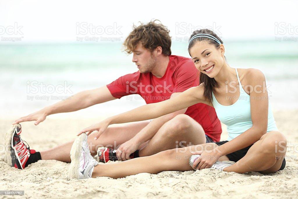 Couple training on beach royalty-free stock photo