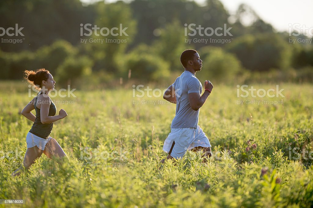 Couple Training Together on a Run stock photo