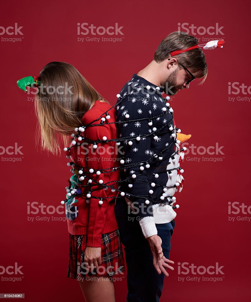 Couple trapped in fairy lights stock photo