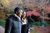 Couple travelers enjoying views at autumn temple