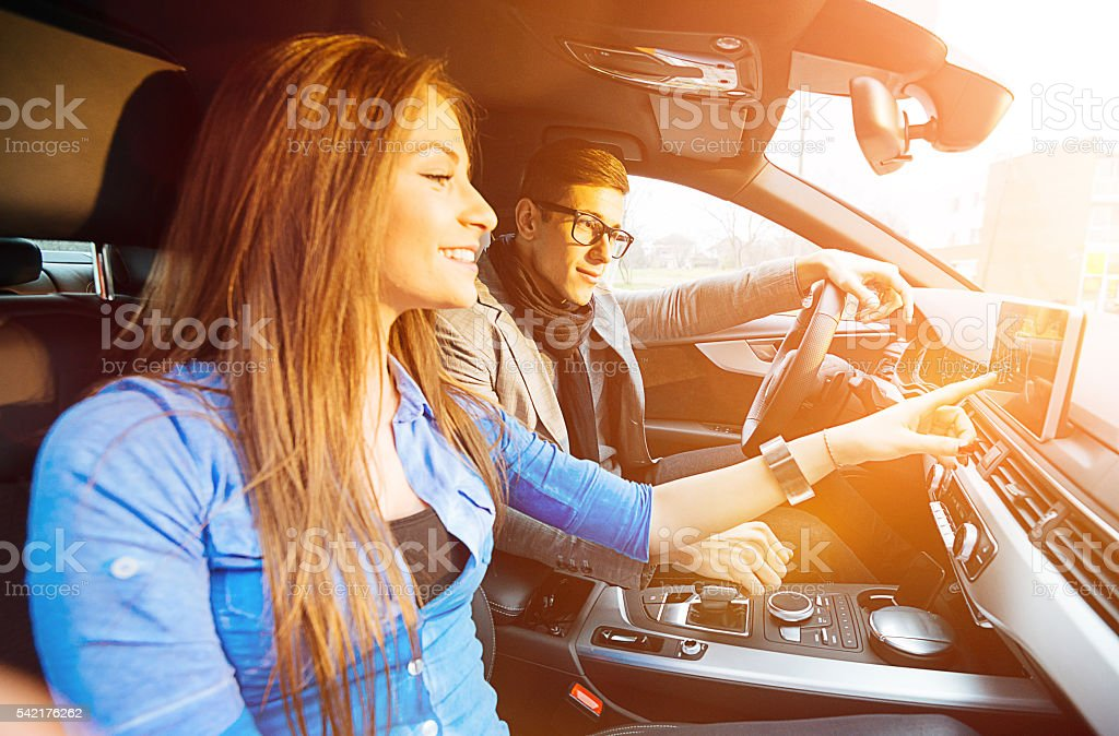 Couple traveling by car, using GPS stock photo
