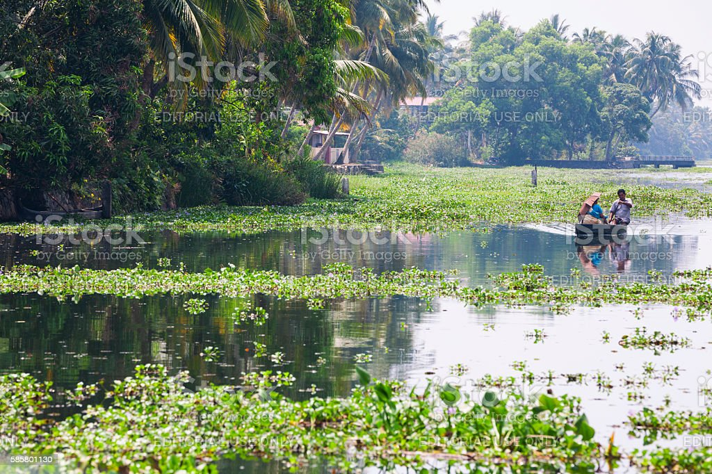 Couple traveling by Kettuvallam on the Kerala Backwaters, India stock photo
