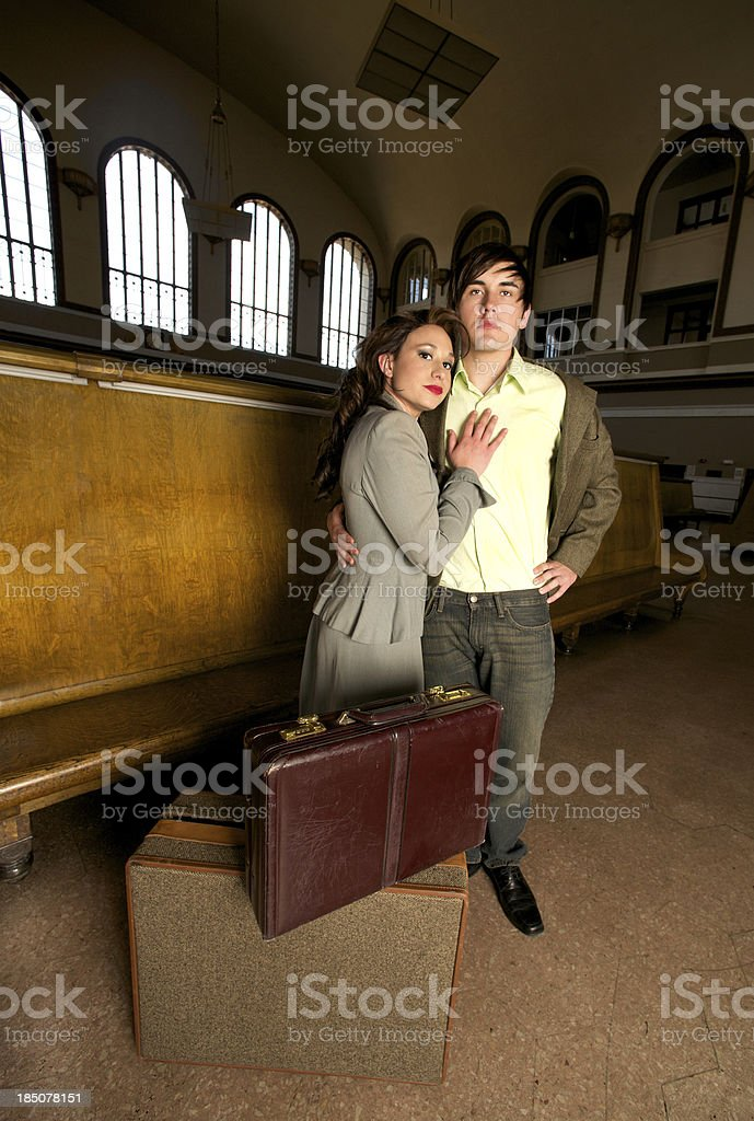 Couple Traveling in  Historic Train Station stock photo