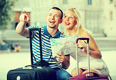 couple travellers holding map