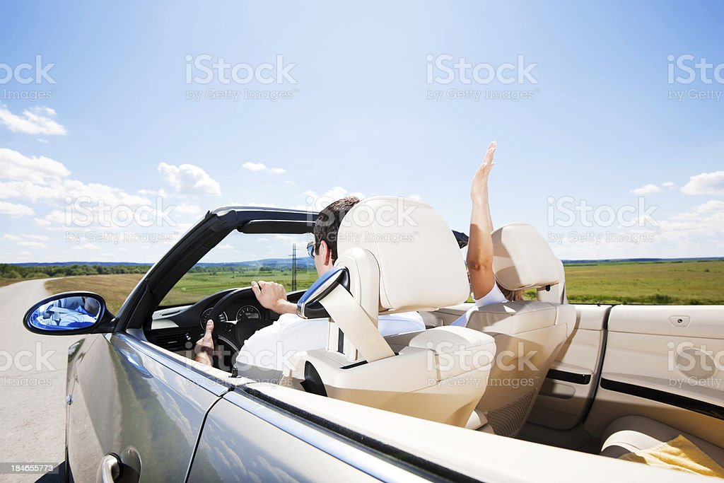 Couple travelling in a Convertible car stock photo