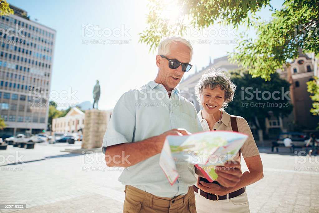 Couple travelling in city with a road map stock photo
