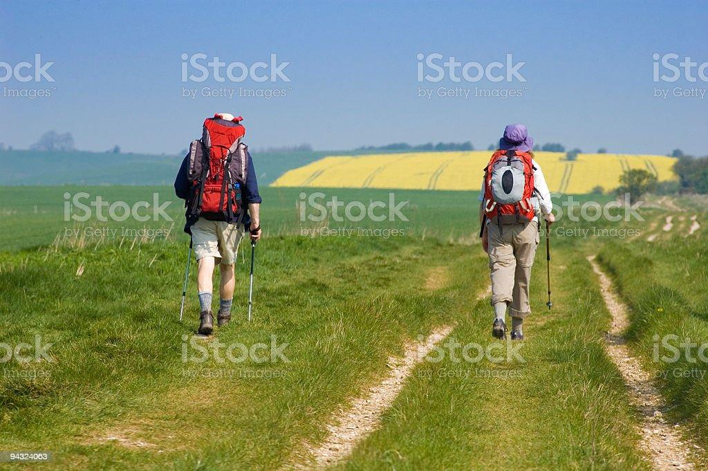 Couple trekking along trail royalty-free stock photo