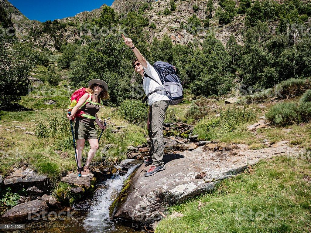 Couple trekking in the mountains stock photo