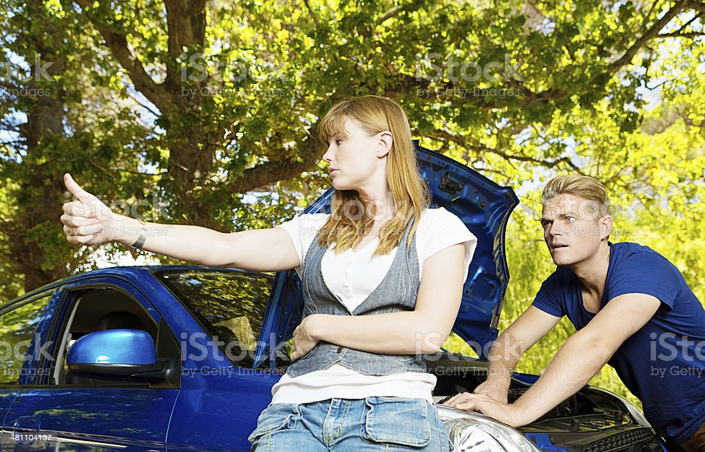 Couple trouble. If you can't fix the car, I'm hitchhiking! stock photo