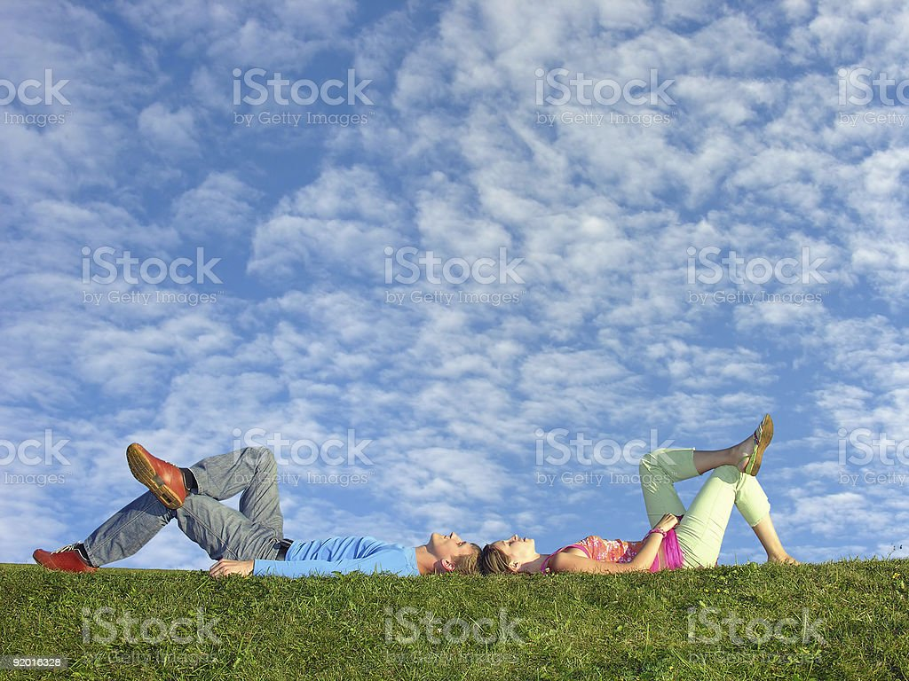 couple under cloudfield stock photo