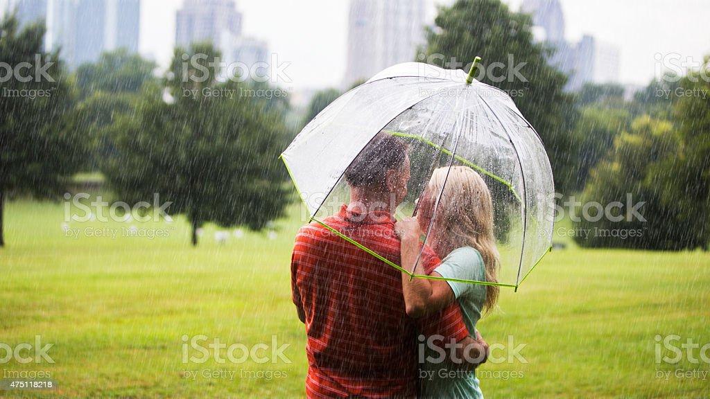 Couple under umbrella in the Park in Atlanta, Ga stock photo