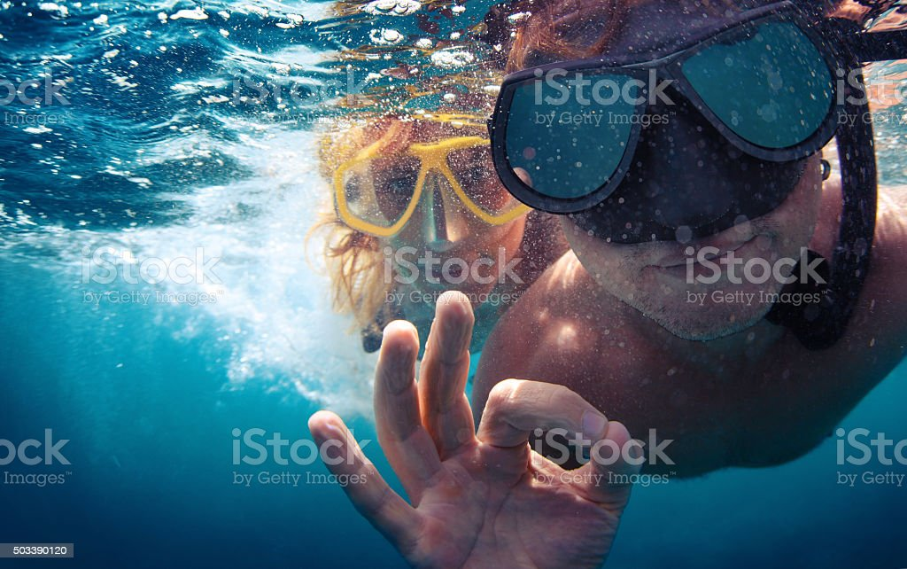 Couple underwater stock photo