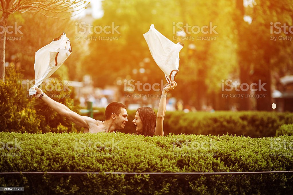 Couple undress in the city stock photo