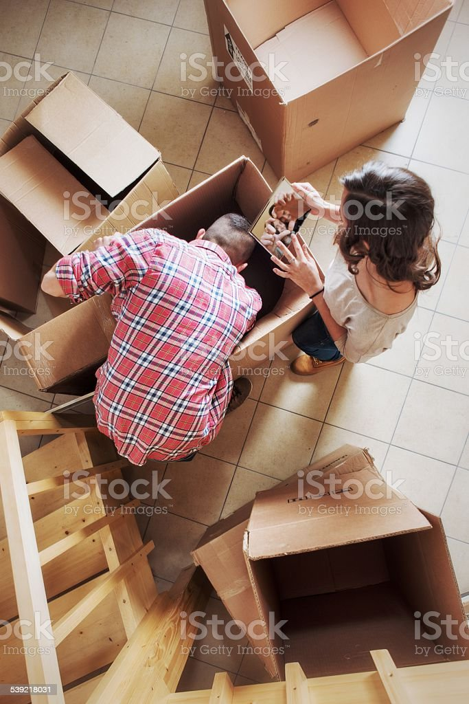 Couple Unpacking Boxes During a Moving stock photo