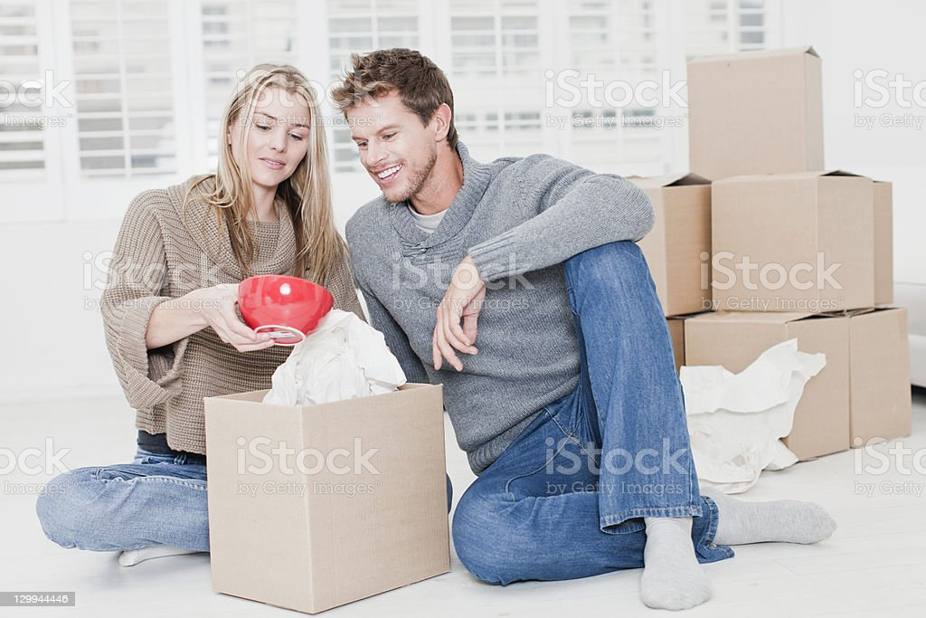 Couple unpacking boxes in new home royalty-free stock photo