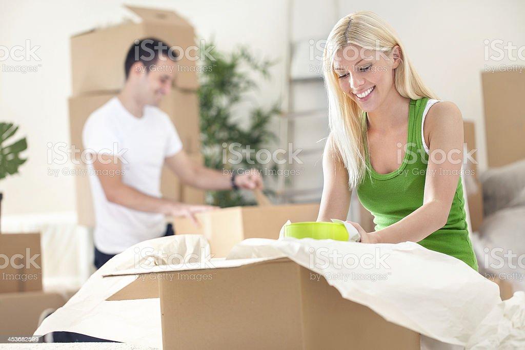 Couple unpacking boxes stock photo