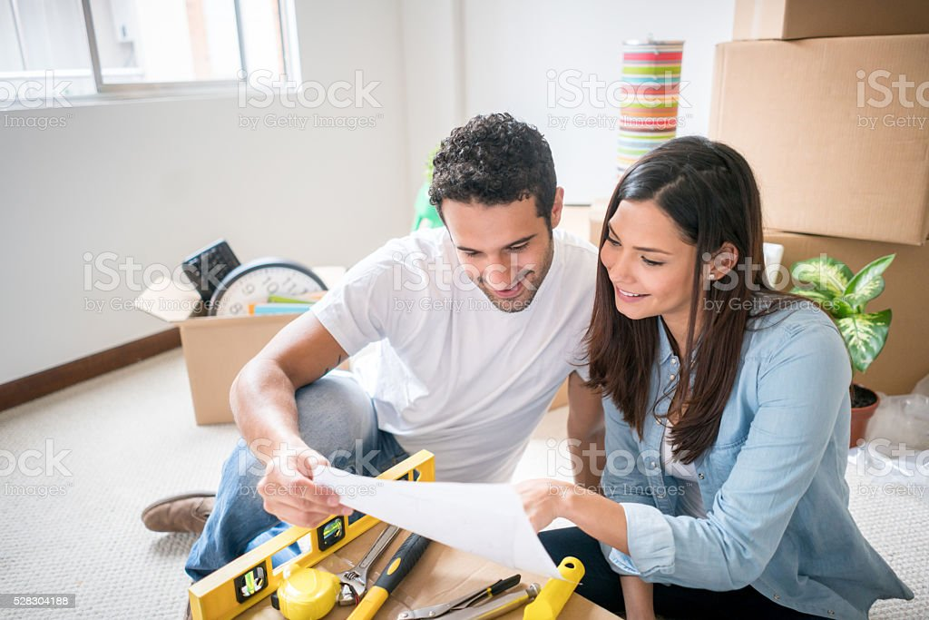 Couple unpacking in their new home stock photo