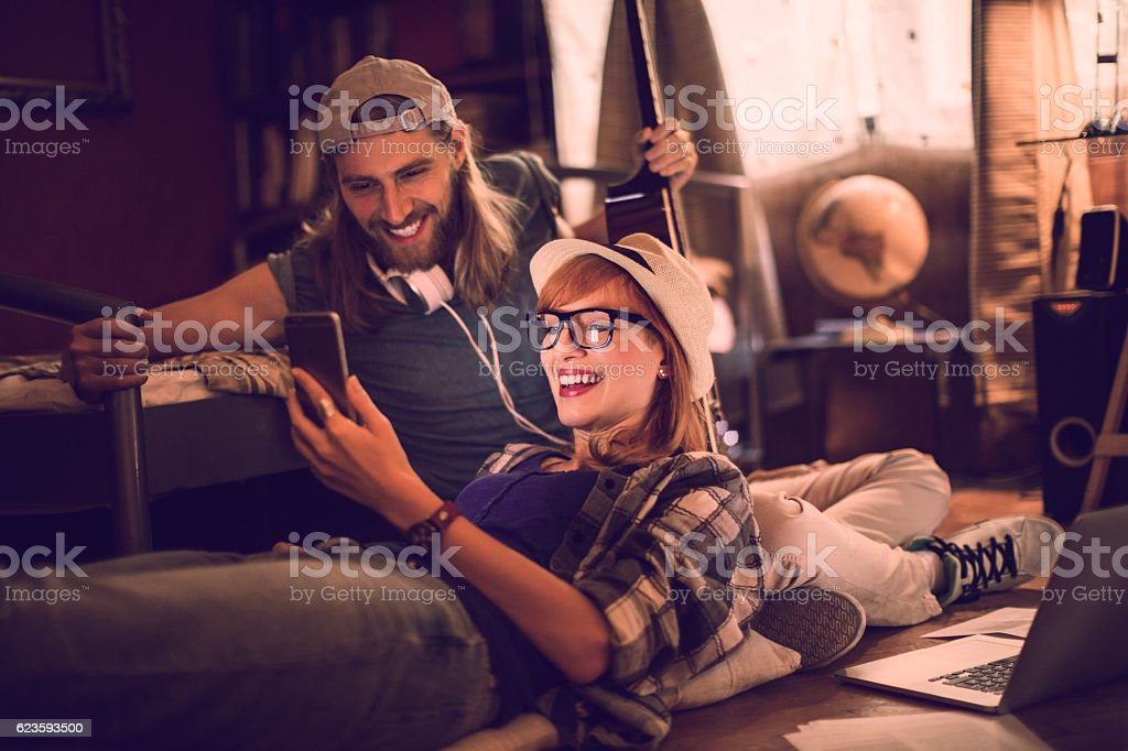 Couple using a phone stock photo