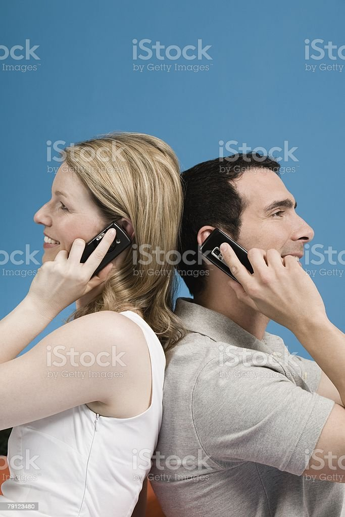 Couple using cellphones royalty-free stock photo