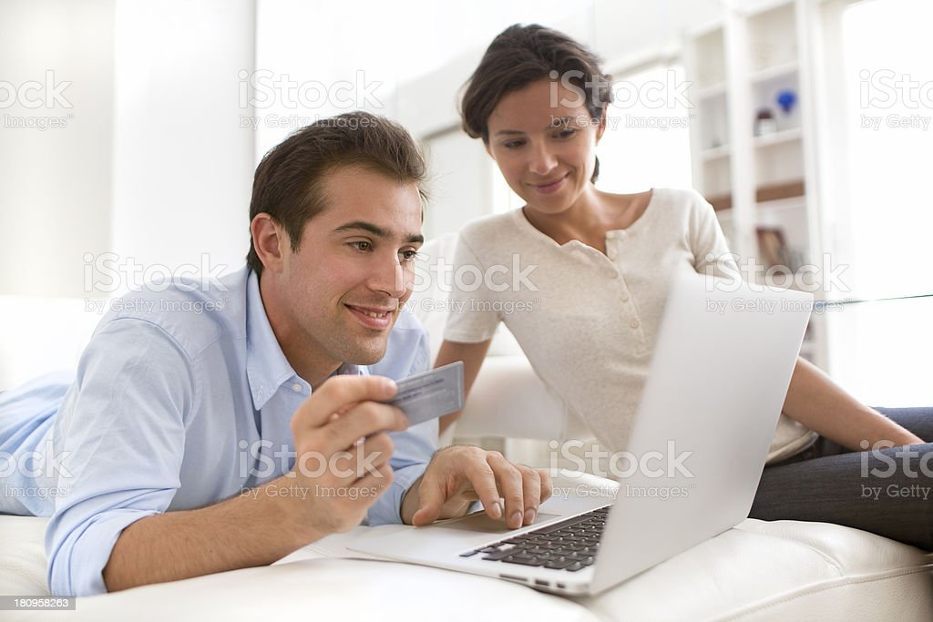 Couple using credit card to shop online royalty-free stock photo