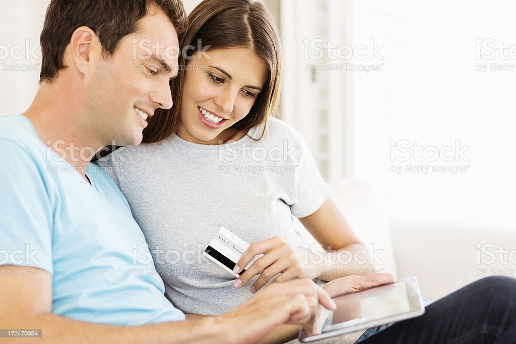 Couple Using Digital Tablet And Credit Card royalty-free stock photo