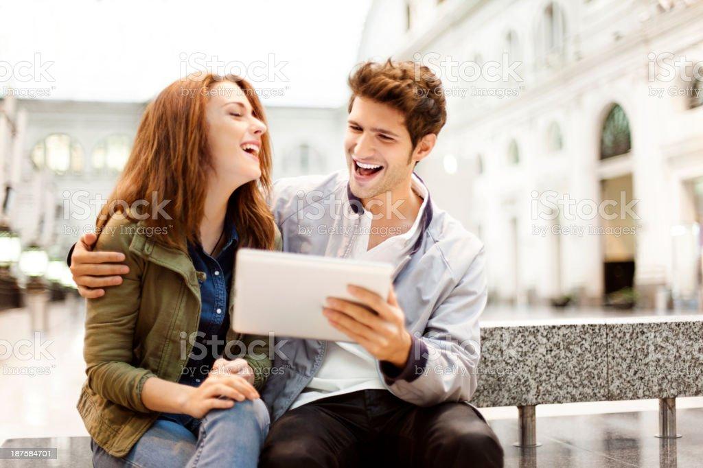 Couple using digital tablet stock photo