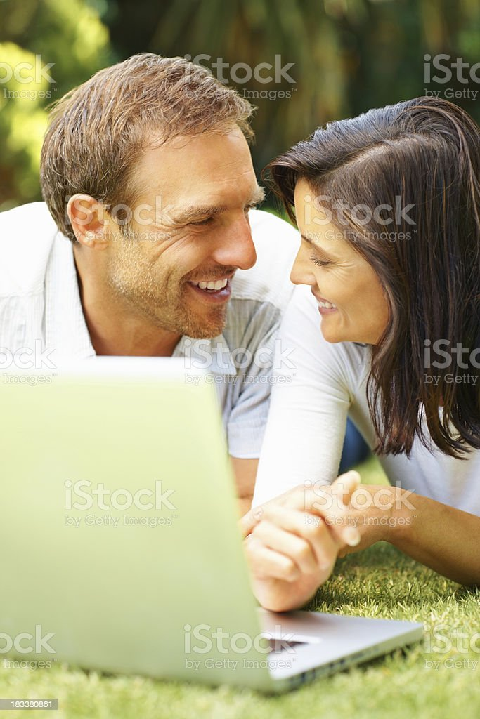 Couple using laptop royalty-free stock photo