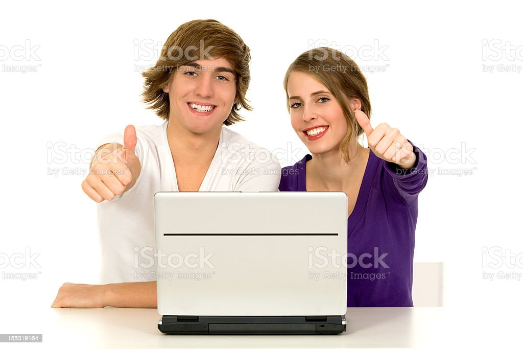 Couple using laptop showing thumbs up royalty-free stock photo