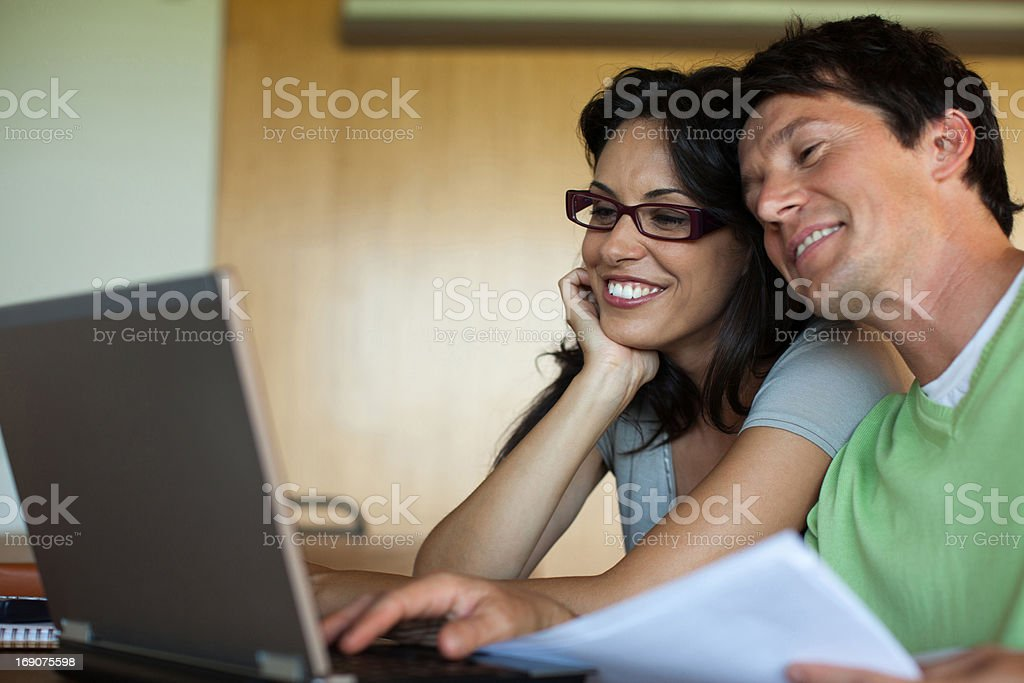 Couple using laptop together royalty-free stock photo