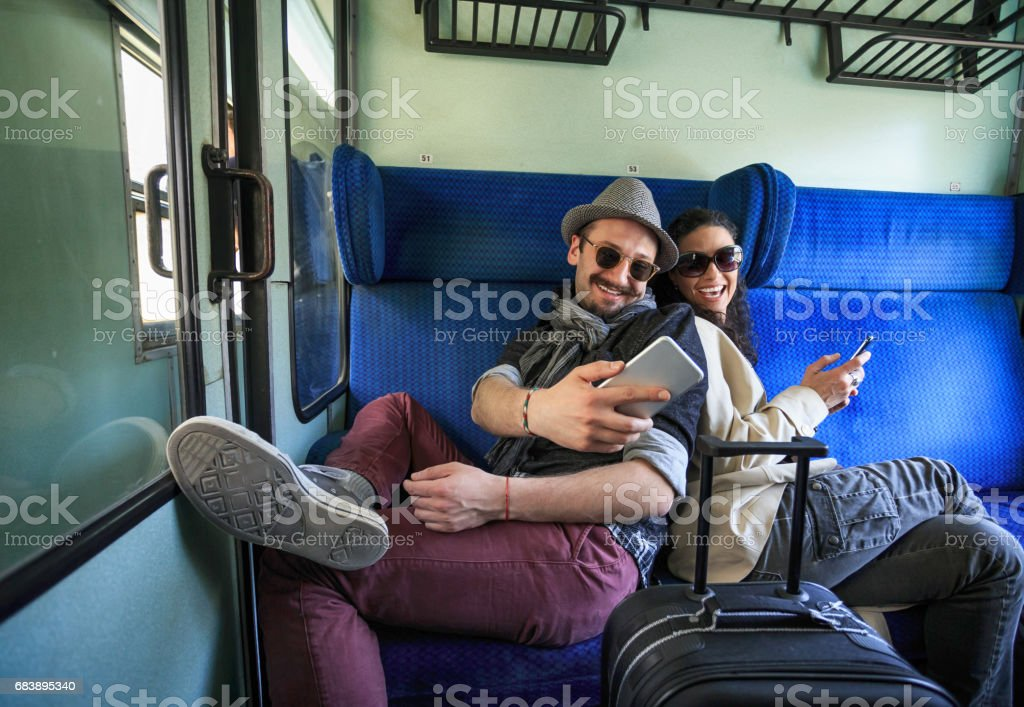 Couple using smart phones inside of a train stock photo