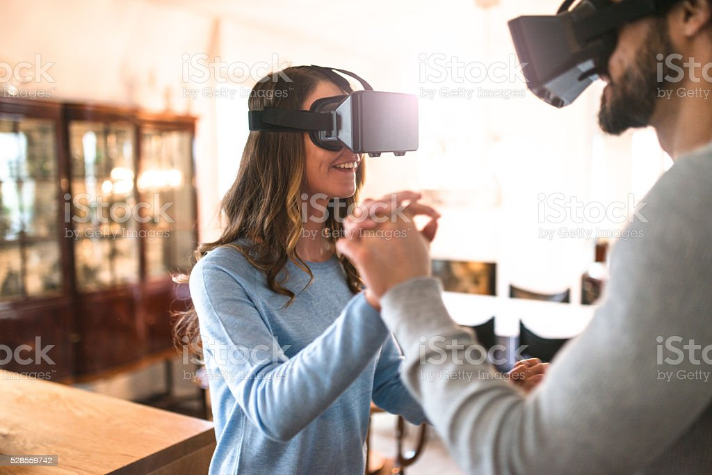 couple using the VR simulator at home stock photo