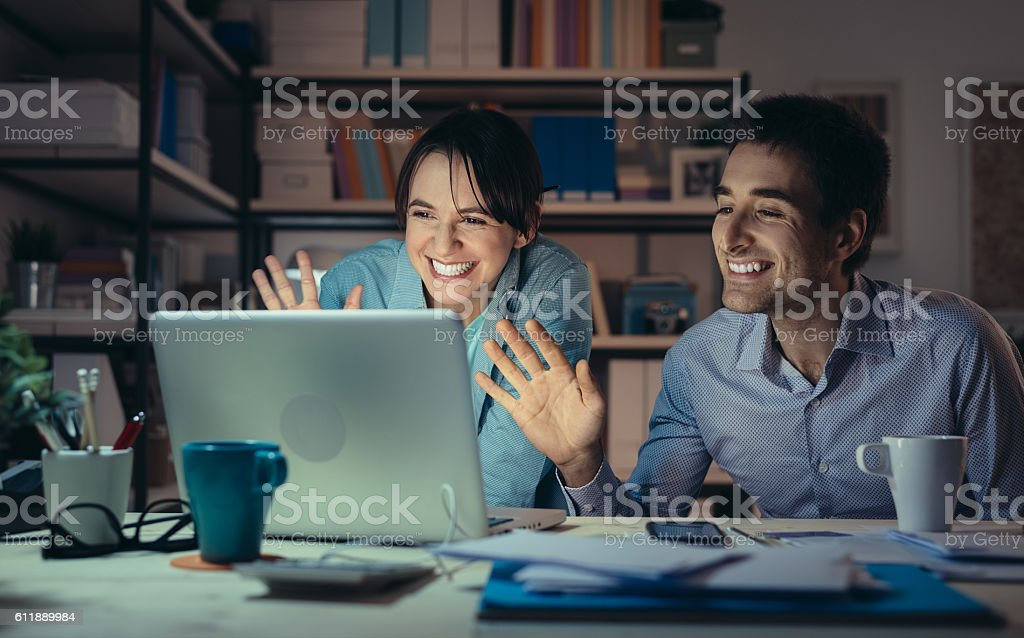 Couple video calling their friends stock photo