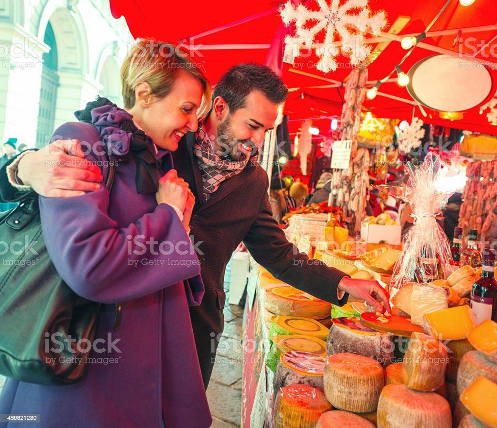 Couple visiting Christmas Market, Milan stock photo