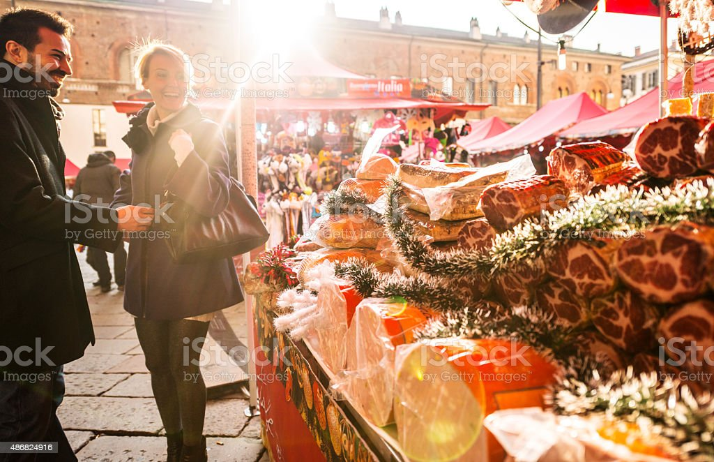 Couple visiting Christmas Market, Milan stock photo