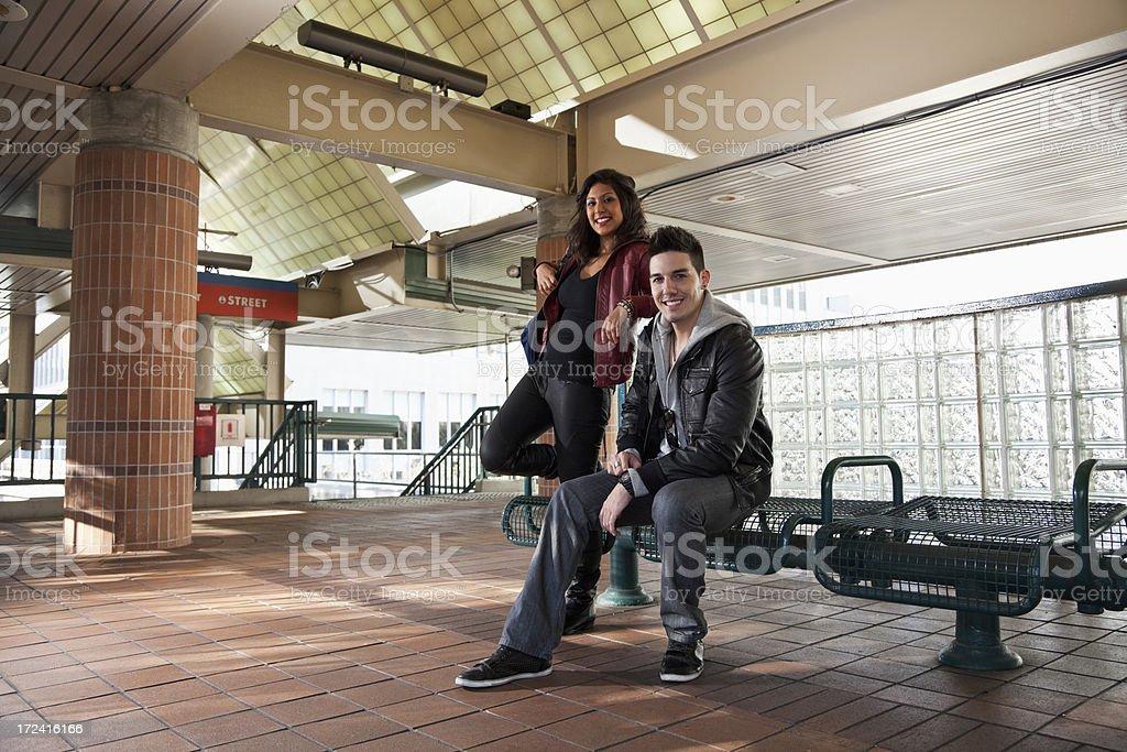 Couple waiting on train platform royalty-free stock photo