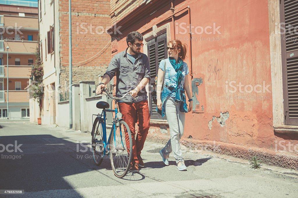 couple walkin on the street stock photo