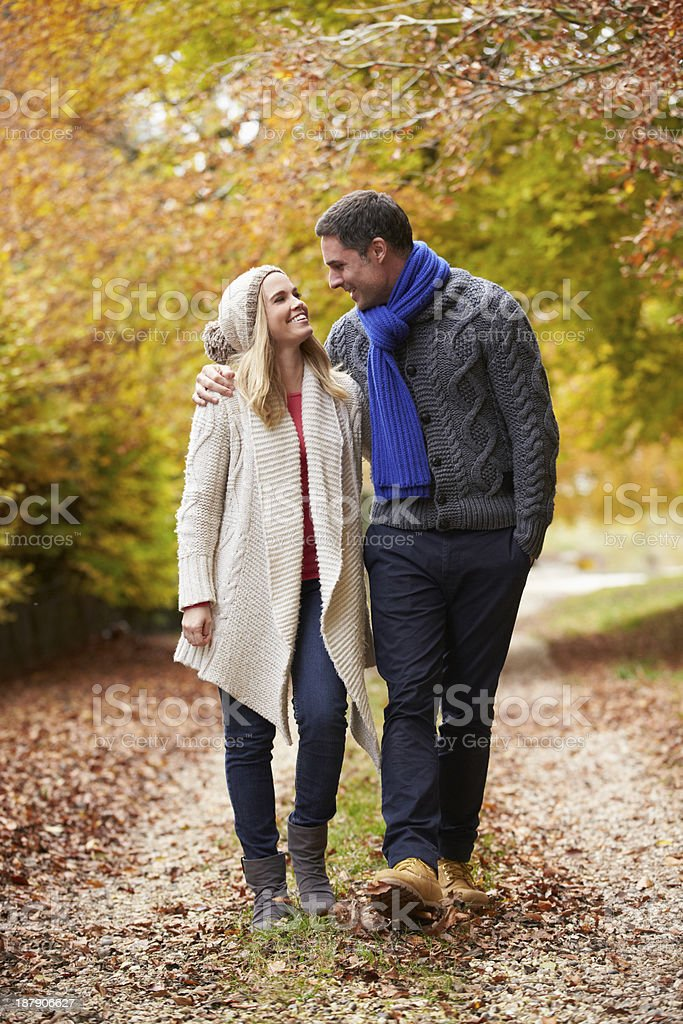 Couple Walking Along Autumn Path royalty-free stock photo
